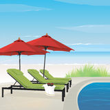 Relaxing Resort on Beach. Relaxing resort on tranquil beach with pool, lounge chairs and umbrellas. Easy-edit layered file Royalty Free Stock Photos