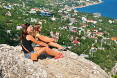 Relaxing on a rock in the mountains Stock Photography