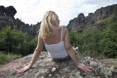 Relaxing on a Rock. Woman relaxing on a rock Royalty Free Stock Photos
