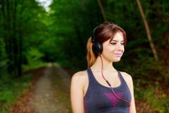 Relaxing runner resting and listening to music on headphones Stock Images