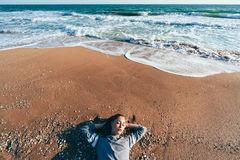 Relaxing on sand by the sea wave, fall beach concept. Stock Images