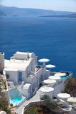 Relaxing in Santorini. Hotel terrace with swimming pools and umbrellas. Beautiful view at the seaside. Santorini, Greece Stock Photography
