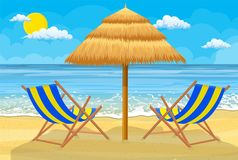 Relaxing scene on a breezy day. At the tropical beach. two deck chair and umbrella Stock Photo