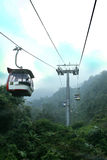 Relaxing and scenic ride in cable car skyway. Cable car travel adventure through the trees in the mist at Malaysia stock photos