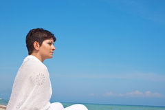 Relaxing by the sea Stock Photography