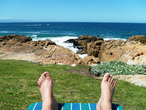 Relaxing by the seaside Stock Photography