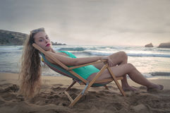 Relaxing at the seaside and posing Royalty Free Stock Images