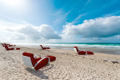 Relaxing seats on the beach Stock Photo