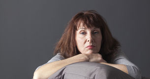 Relaxing senior woman sick of having menopause blues Stock Image