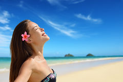 Relaxing serene woman on Hawaii Lanikai beach. Relaxing serene woman portrait on Hawaii Lanikai beach. Young mixed race female by water relaxed during summer Royalty Free Stock Photo