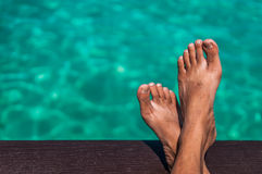 Relaxing. A shot of relaxation gesture with crossed legs overlooking the ocean Stock Photography