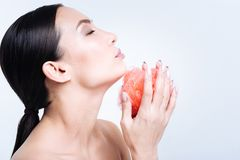 Side view of beautiful woman cupping bath sponge in hands Stock Photo