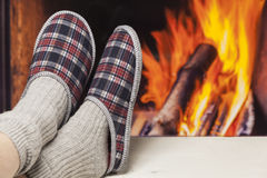 Relaxing in slippers at fireplace Stock Image
