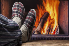 Relaxing in slippers at fireplace Royalty Free Stock Photography