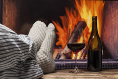 Relaxing in slippers at fireplace Royalty Free Stock Photos