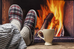 Relaxing in slippers at fireplace Stock Photography