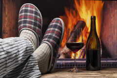 Relaxing in slippers at fireplace Royalty Free Stock Image