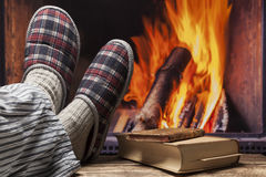 Relaxing in slippers at fireplace Stock Photo