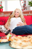 Relaxing smiling pregnant woman Royalty Free Stock Photography