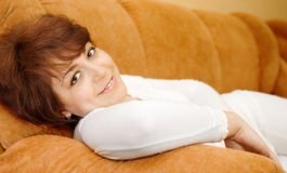 Relaxing smiling young woman in white dress Stock Photo