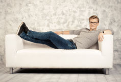 Relaxing on a sofa Stock Photography