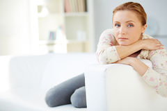 Relaxing on sofa Stock Images