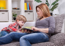 Relaxing with son and tablet Royalty Free Stock Photo