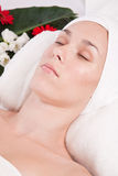 Relaxing in the spa. Beautiful woman with towel on her head relaxing in the spa Royalty Free Stock Images