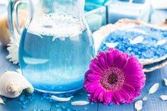 Relaxing spa bath aromatic salt shells flowers Stock Photos
