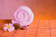 Relaxing spa massage with a candle warm light. Royalty Free Stock Images