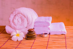Relaxing spa massage with a candle warm light. Stock Images