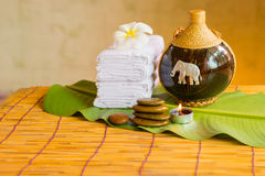 Relaxing spa massage with a candle warm light. Stock Photo