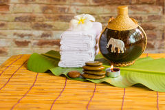 Relaxing spa massage with a candle warm light. Royalty Free Stock Photos
