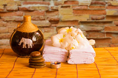 Relaxing spa massage with a candle warm light. Royalty Free Stock Photo
