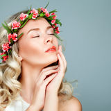 Relaxing Spa Model Blonde Woman. With Healty Clean Skin and Flowers. Antiaging and Cosmetology Stock Photo