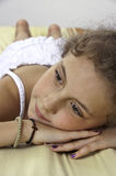 Relaxing in spa room. Little girl relaxing on a massage bed in spa Stock Photo