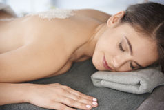 Relaxing at the spa salon. Natural woman at the luxurious spa Stock Photography