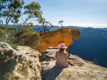 Relaxing with spectacular views of cliffs and mountains stock images