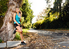 Relaxing sport  woman. Healthy happy fitness woman resting in suburb with water bottle after workout exercise session. vitality lifestyle runner Royalty Free Stock Images