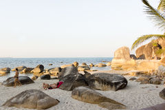 Relaxing among the stones on Silver Beach Stock Photo