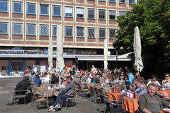 Relaxing in a street cafe on a sunny day Royalty Free Stock Images