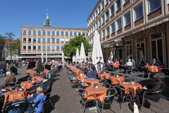 Relaxing in a street cafe on a sunny day Stock Photography