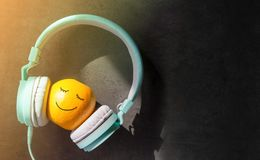 Relaxing in Summer with Music Concept, present by Orange Fruit L. Relaxing in Summer with Music Concept, present by Orange t Listening in Headphone, Happy Smiley Stock Image