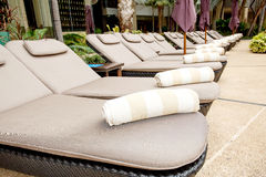 Relaxing sun beds at swimming pool Royalty Free Stock Photography