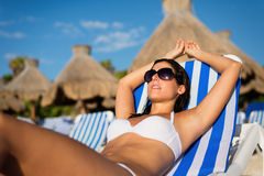 Relaxing and sunbathing on summer tropical vacation at the beach Royalty Free Stock Photography
