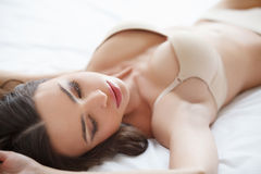 Relaxing at Sunday morning. Beautiful young women lying on the s Royalty Free Stock Images