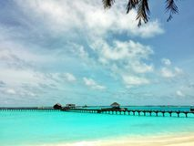 Relaxing in Sunny beach of Maldives Royalty Free Stock Photos
