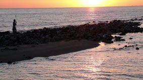 Relaxing sunset at Roman beach in Ostia Lido coast with scenic pastel-colored