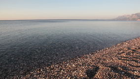 Relaxing surf stones sunset HD. Shot in HD with macro focus on pebbles as surf washes over beach at sunset.High quality HD video footage stock footage