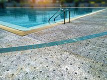 Relaxing swimming,holiday in resort with modern luxury pool. In morning time Royalty Free Stock Photo